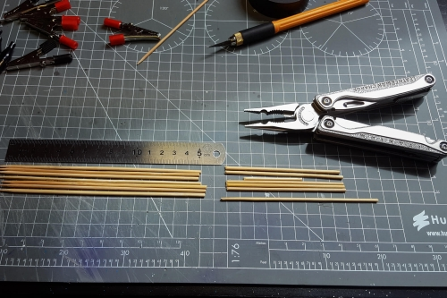 Cutting skewers to size.
