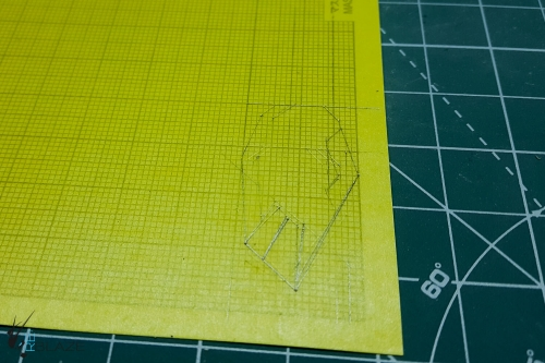 Drawing the design on a masking sheet.